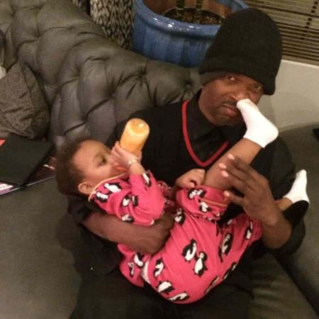 Wayans with his child