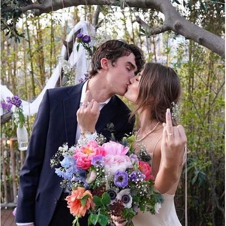 Deaken Bluman with her wife Elin Bluman in their wedding