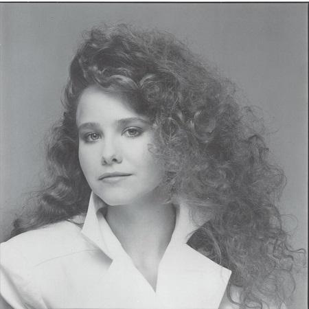 Molly Hagan with 1980s hair