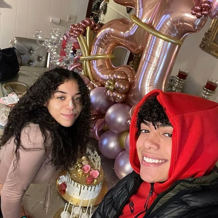Derek with his sister on her 15th birthday,