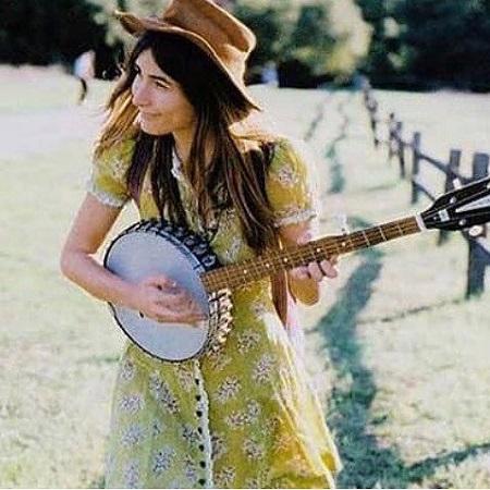 Jade playing guitar,
