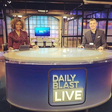 Erica hosting on DAILY BLAST LIVE by social distancing with her co-host Jeff,