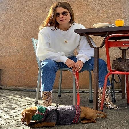 Priscila with her dog Simon travelling around, source Instagram