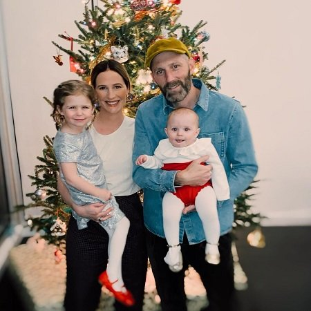 Annie with her family celebrating Christmas eve,