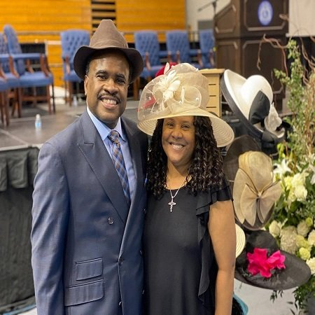 Lelan & Yolanda giving their final tribute and salute following Ms. Harper's Celebration of Life next to some of the senator's hats on display.