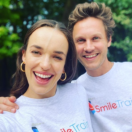 Elizabeth with her fiance on WORLDE SMILE DAY, source Instagram