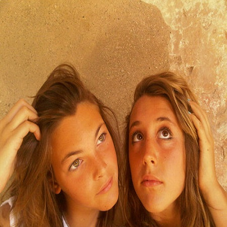 Vittoria with her best friend in their childhood,