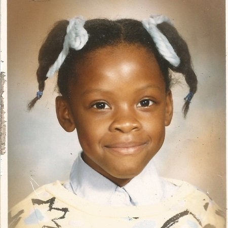 Karimah's chilhood pic while attending school, source Instagram_files