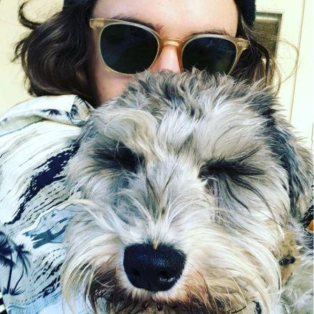 Deacon posing with his pet, source Instagram