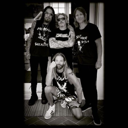 Dave with his band members, source Instagram