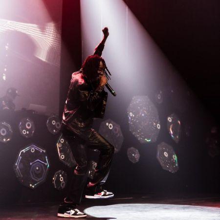 KayCyy performing on stage, source Instagram