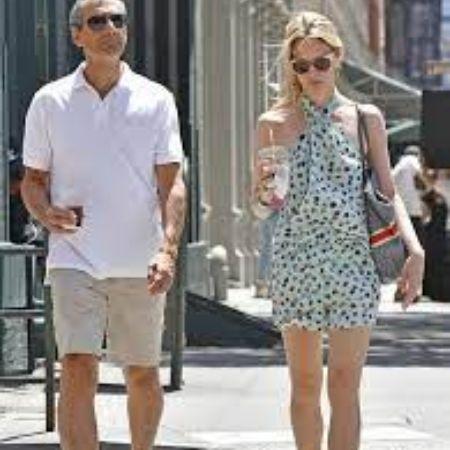Dan with his wife walking around, source Pinterest (1)