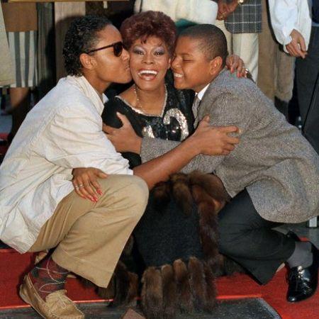 David Leland and his brother kissing his mom, source Heart Radio (1)