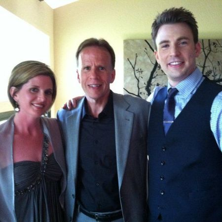 G. Robert Evans III with his current wife and his son Chris Evans, source Pinterest