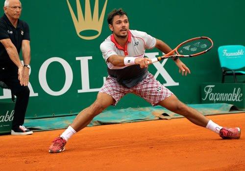 Stan Wawrinka playing tennis, source The Sport Review