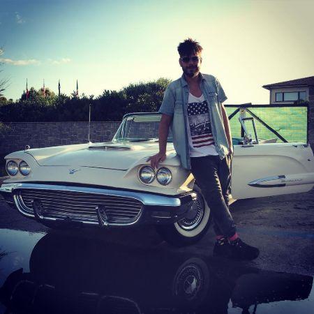Nevio Passaro posing with his car