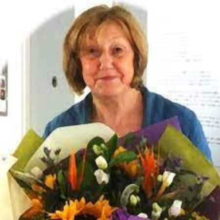 Chrissie Heughan holding flowers